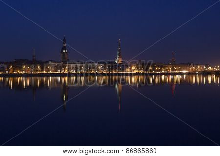 Night view of Riga centre with reflection in Daugava