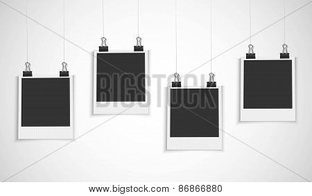 Blank photo frames hanging on a line