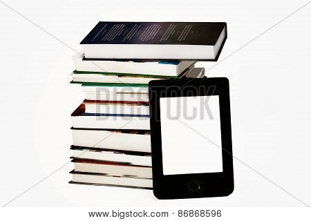 E-book reader and stack of books