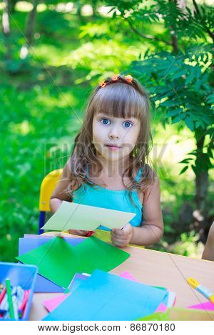 Girl, Kid, Child,  Schoolgirl Preschooler Cutting Multicolored Paper Outdoors