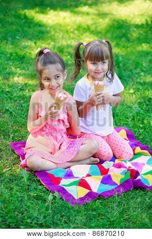 Girls kids sisters friends teasing eating ice cream