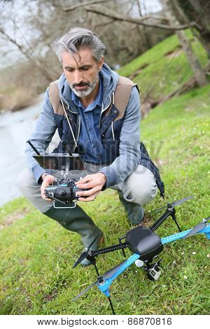 Man operating a drone with remote control