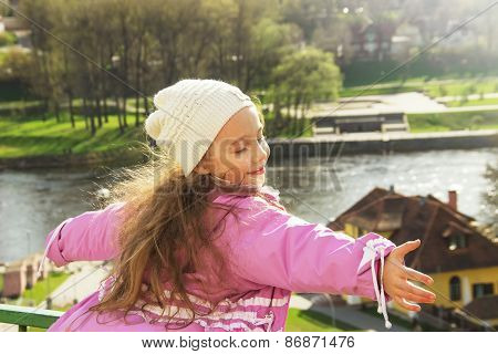 Cute child shone with happiness curly hair charming smile in the sunny spring day