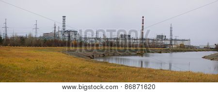 Panoramic view of the fourth reactor of the Chernobyl nuclear power station with cooling pond