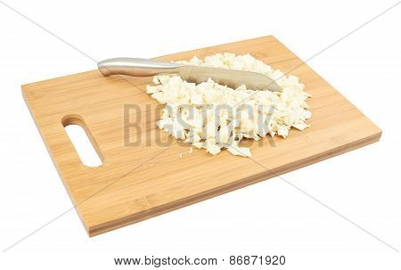 Cut in pieces white cabbage over cutting board