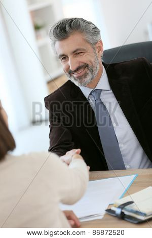 Attorney shaking hand to client after meeting