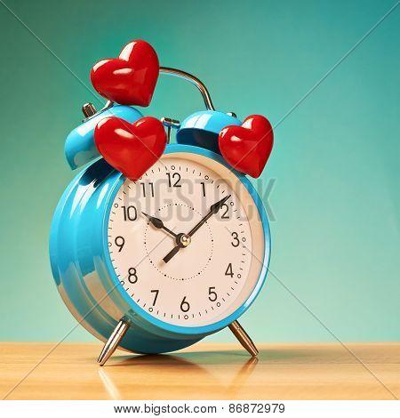 Alarm clock with three hearts over