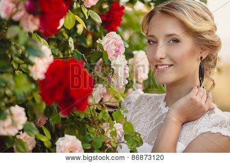 Portrait of a beautiful girl in the Park among the flowers.