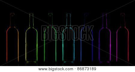 Row of rainbow colored bottles