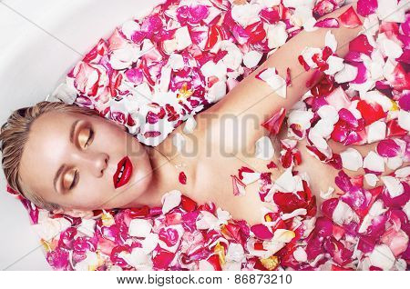 Portrait Of A Sensuall Blonde Woman In Water With Rose Petal, Spa Concept