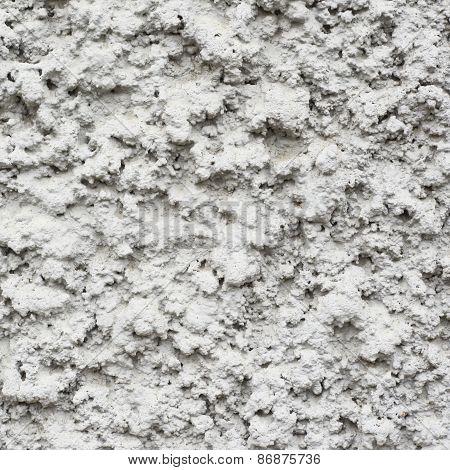 Bumpy concrete wall fragment