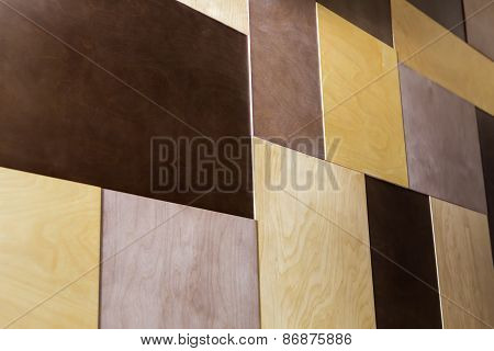 Decorative wood tile plywood in different colors. Decorating the
