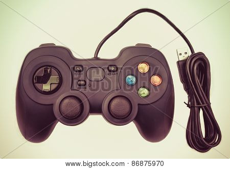 Old Black Joystock For Console Video Game In Isolated Background In Retro Color