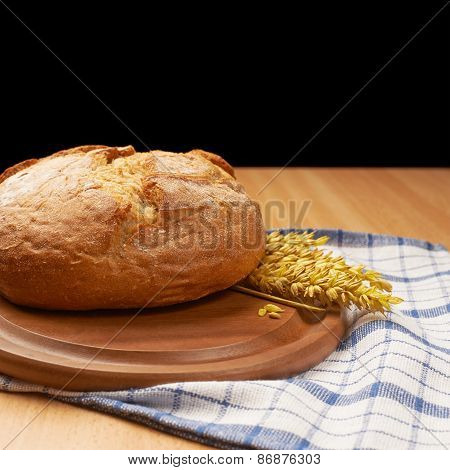 Ears of wheat and bread composition