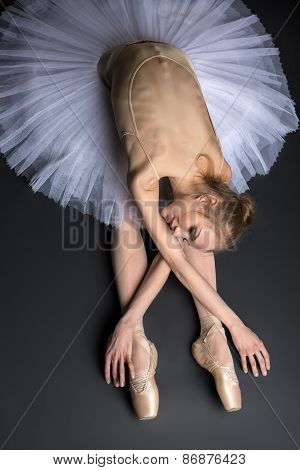 Ballerina sitting on the floor