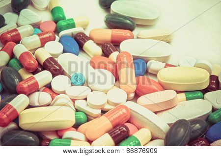 Pile Of Pills In White Isolated Background In Vintage Color