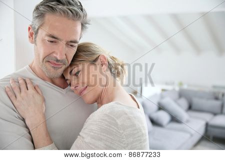 Mature man embracing wife and feeling good