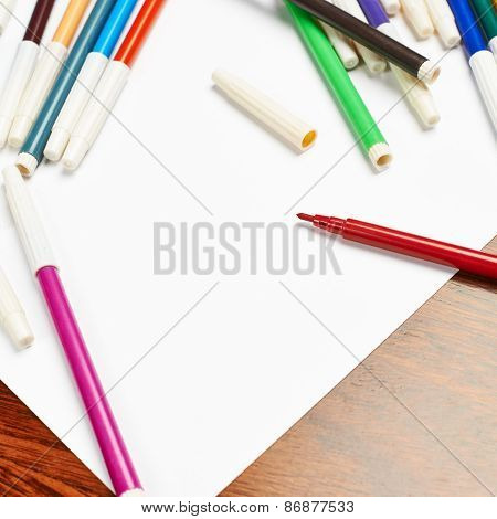Blank sheet of paper covered with markers