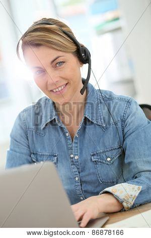 Active woman teleworking from home