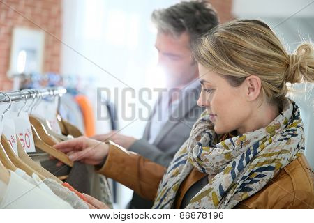 Mature couple shopping in clothing store