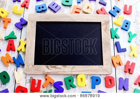 wooden alphabet blocks as a frame - education
