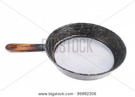 Old burnt pan isolated