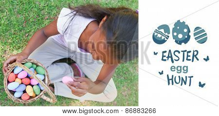 easter egg hunt graphic against little girl sitting on grass counting easter eggs