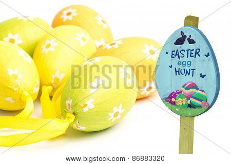 Easter egg hunt sign against six easter eggs