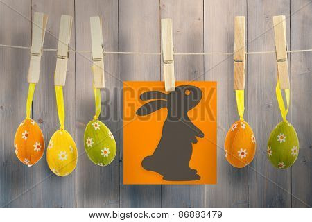 easter bunny against pale grey wooden planks