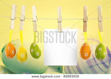 hanging easter eggs against striped and spotted easter eggs