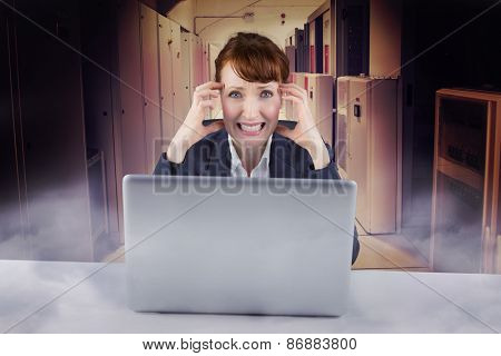 Stressed businesswoman against data center