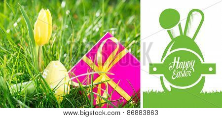 happy easter graphic against pink gift box with easter egg and yellow tulip