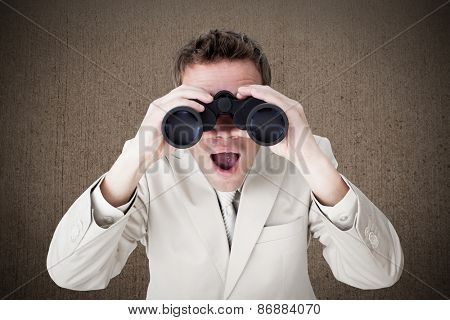 Positive businessman using binoculars against weathered surface