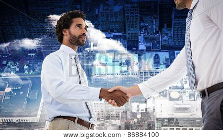 Young businessmen shaking hands in office against new york
