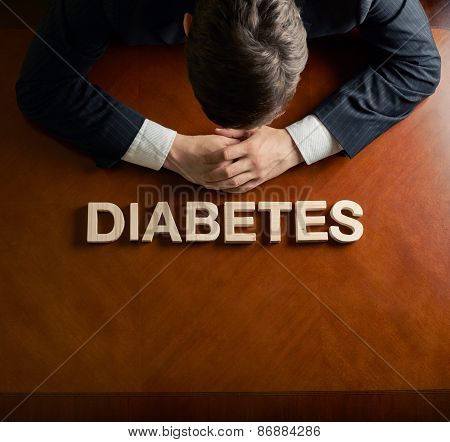 Word Diabetes and devastated man composition