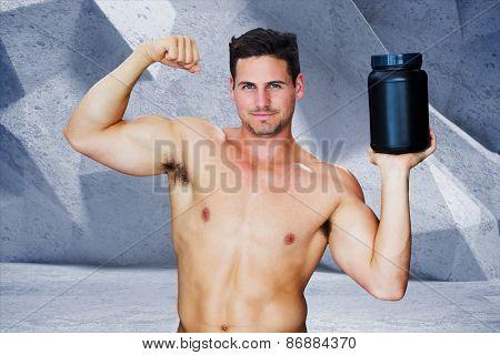 Bodybuilder with protein powder against grey angular background