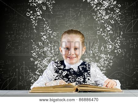 Schoolgirl with opened book against sketch background