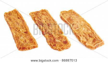 Dried meat strip snack isolated