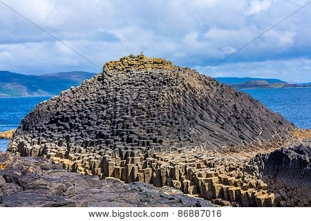 Staffa from the Old Norse for stave or pillar island is an island of the Inner Hebrides in Argyll and Bute Scotland. The Vikings gave it this name as its columnar basalt reminded them of their houses which were built from vertically placed tree-logs.