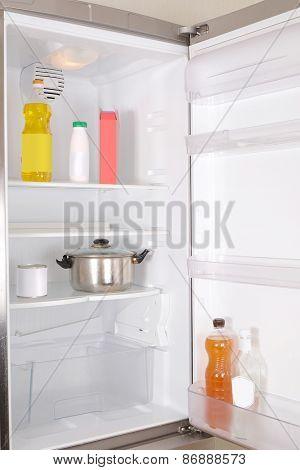 Stainless steel refrigerator -  door is open
