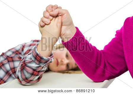 Adult arm wrestling with young girl