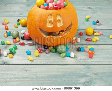 Jack o lantern pumpkin filled with candies