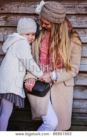 happy mother and daughter on the walk at wooden country house