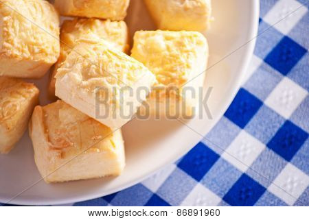 Cheese scones close up on blue checkered tablecloth