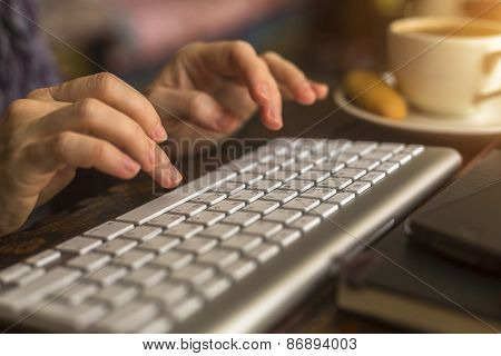 Female typing on the computer keyboard.