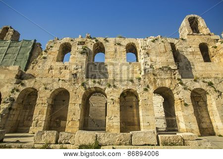 Walls of ancient theater under Acropolis of Athens, Greece.