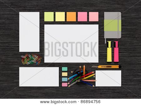 Top View Of Blank Colorful Stationery Mock Up On Black Office Desk Surface