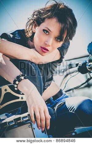 young beautiful woman sitting on motorbike, sunny day outdoor