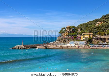 Small pier and view of Mediterranean sea from town of Recco in Liguria, Italy.