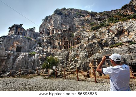 Tourists Take Pictures Rock-cut Tombs Ancient Town Myra, Antalya, Turkey.